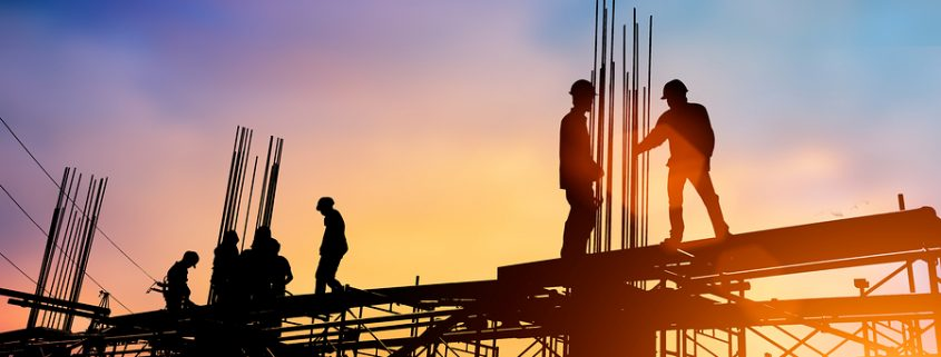 Silhouette engineer standing orders for construction crews to work safely